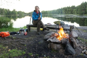 Amanda next to the campfire on night 2 of wild camping, drinking the last of the Champagne we had biked this far
