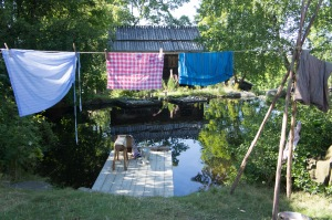 Clothing hanging by a washing pond at Skansen.