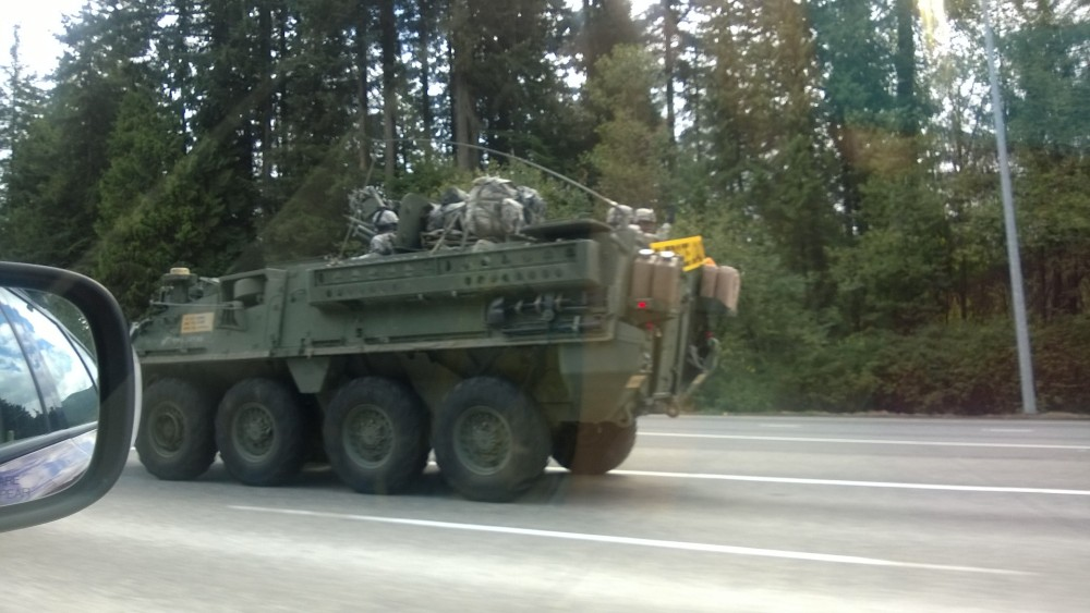 We passed a military convoy at battle stations driving I-90 East.