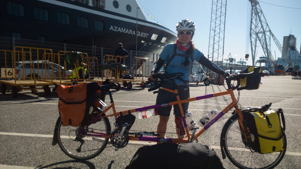 Putting all of our luggage on the bike and leaving the cruise ship for the last time. One of the ship's employees asked to take our photo, as we might be the only guests to ever bike away from the cruise ship.