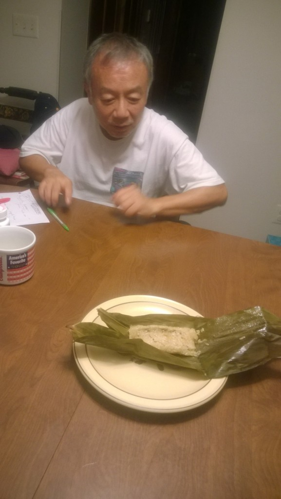 The first sticky rice packets from the steamer moment of truth. I though about putting a birthday candle on top.