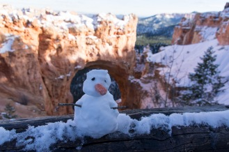 Someone built a fun snowman near this arch pull-off on the scenic drive.