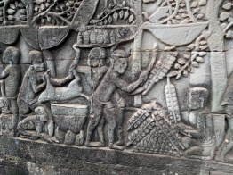 Daily life bas relief at Bayon. These guys are cooking skewers of meat.