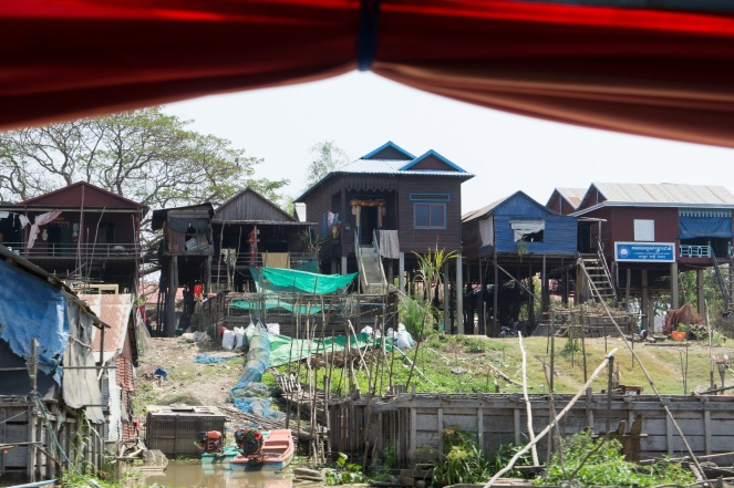 Houses on the riverbanks set on stilts for the rainy season. During the monsoon, the Mekong River backs up in the lake and water levels rise drastically.