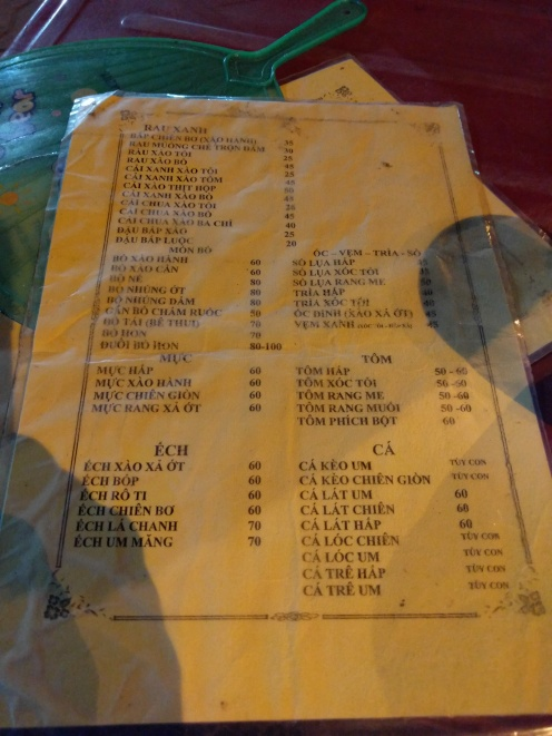 Here's menu page to give you an idea what it's like. We ordered three meat plates plus the veggie (15k vnd). With (6?) beers, we spent 240k vnd. Tom = shrimp, Muc = squid, Oc = snail, ca = fish, bo = beef