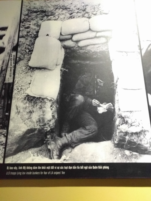 "Caption = "" US troops lying low inside bunkers for fear of LA snipers fire."" Khe Sanh Air Base Museum"