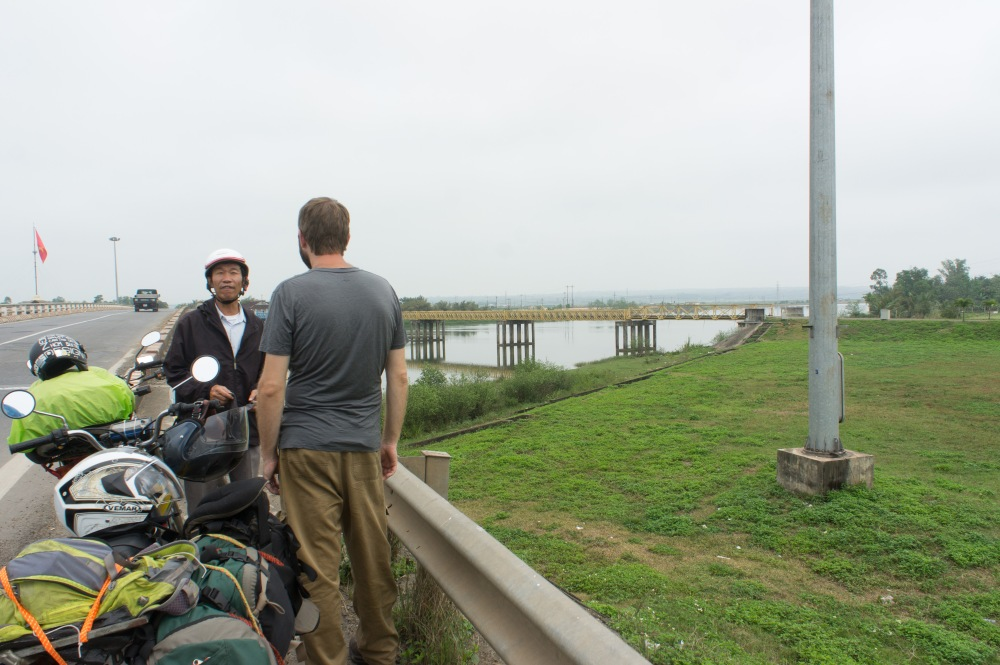 Checking out the Reunification bridge in the DMZ with our guide Mr. Hoa