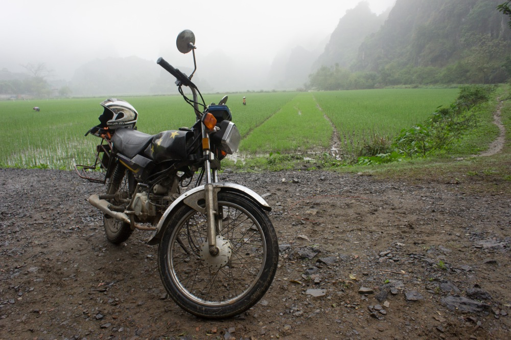 Bike glamour shot with karst and rice paddies.