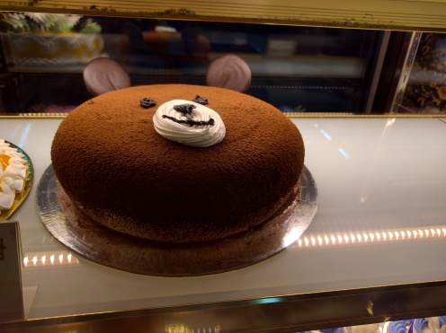 Pedobear cake in Lang Son. After dinner, we found a strip of bakeries with amazing cakes at ridiculous prices and bought a bunch of desserts to try.